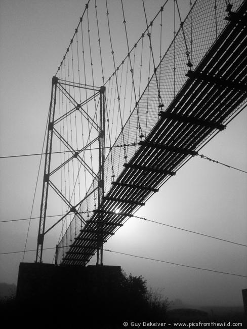 Trail bridge in the haze, Pharping, Nepal (2013)